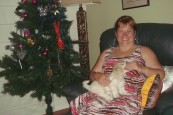 Kerrie and Lucy seated near teh Christmas tree